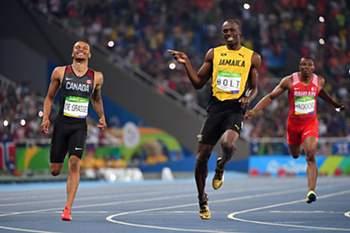 Bolt e André de Grasse numa eliminatória dos 200 metros