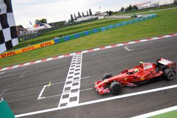 epa01391864 Brazilian Formula One driver Felipe Massa of Ferrari passes the finish line with a checkered flag after he won the race of the Formula One Grand Prix at the Magny Cours race track near Nevers in France, 22 June 2008.