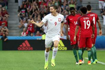 epa05399747 Robert Lewandowski of Poland celebrates after scoring the 1-0 goal during the UEFA EURO 2016 quarter final match between Poland and Portugal at Stade Velodrome in Marseille, France, 30 June 2016. (RESTRICTIONS APPLY: For editorial news reporting purposes only. Not used for commercial or marketing purposes without prior written approval of UEFA. Images must appear as still images and must not emulate match action video footage. Photographs published in online publications (whether via the Internet or otherwise) shall have an interval of at least 20 seconds between the posting.) EPA/OLIVER WEIKEN EDITORIAL USE ONLY