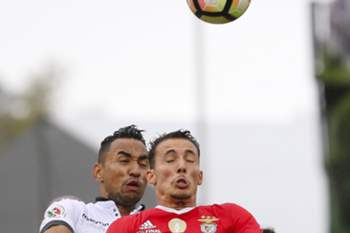 Benfica's player Grimaldo (R) vies for the ball against Vitoria de Guimaraes player Pedro Henrique (L) during their Portuguese Cup Final soccer match held at National stadium, in Oeiras, outskirts of Lisbon, Portugal, 28 May 2017. MIGUEL A. LOPES/LUSA