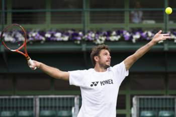 epa04821196 Stanislas Wawrinka of Switzerland performs during a training session for the All England Lawn Tennis Championships Grand Slam tournament in Wimbledon, London, Britain, 27 June 2015. The All England Lawn Tennis Championships will take place from 29 June until 12 July 2015. EPA/PETER KLAUNZER