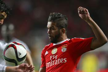 Benfica's player Carcela (R) vies for the ball with Alan of Nacional during their Portuguese League Cup match held at Luz Stadium in Lisbon, Portugal, 29 december 2015. JOSE SENA GOULAO/LUSA