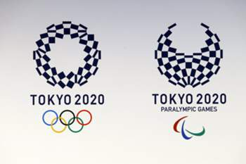 epa05276471 The Tokyo 2020 Olympic and Paralympic Games logo, created by Japanese artist Aso Tokolo, is displayed in Tokyo, Japan, 25 April 2016. The Tokyo 2020 Olympic and Paralympic organizing committeechose the logo from four final candidates which were selected from more than 14,599 entries. EPA/KIMIMASA MAYAMA