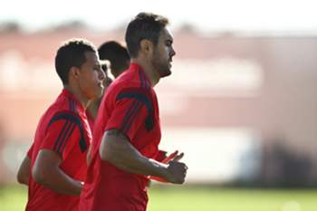 epa04474419 SL Benfica's players Jardel (R) and Lima (L) jog during the team's training session in Seixal, Portugal, 3 November 2014. SL Benfica will face AS Monaco in the UEFA Champions League group C soccer match on 4 November at Luz Stadium in Lisbon. EPA/MARIO CRUZ