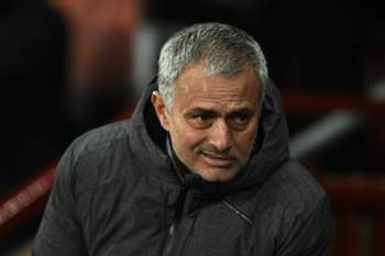 Manchester United's Portuguese manager Jose Mourinho takes his seat for the UEFA Europa League round of 16 second-leg football match between Manchester United and FC Rostov at Old Trafford stadium in Manchester, north-west England, on March 16, 2017. / AFP PHOTO / Oli SCARFF