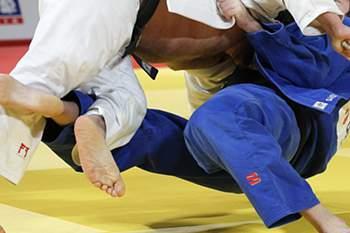 epa04518639 Renat Saidov (blue) of Russia in action against Levani Matiashvili (white) of Georgia on the mat in the men's +100kg category final during the IJF Judo Grand Slam 2014 in Tokyo, Japan, 07 December 2014. EPA/KIYOSHI OTA