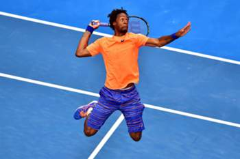 epaselect epa04575261 Gael Monfils of France in action against Jerzy Janowicz of Poland during their second round match at the Australian Open Grand Slam tennis tournament at Melbourne Park in Melbourne, Australia, 22 January 2015. EPA/JULIAN SMITH AUSTRALIA AND NEW ZEALAND OUT