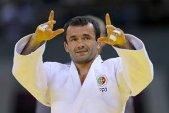epa04818274 Sergiu Oleinic of Portugal reacts after winning against Nijat Shikhalizada of Azerbaikan in the Men's 66kg Judo Quarterfinals at the Baku 2015 European Games in Azerbaijan, 25 June 2015. EPA/ROBERT GHEMENT