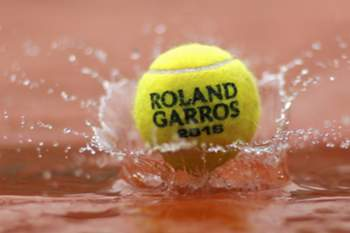 Tennis - French Open - Roland Garros - Paris, France - 23/05/16 An illustration photo shows a tennis ball which drops into water during rainfall. REUTERS/Benoit Tessier