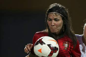 Portugal's player Ana Borges (L) vies for the ball with France's player Jessica Houara (R) during the women's soccer tournament Algarve Cup match held at Parchal, Algarve, Portugal, 04 March 2015. LUIS FORRA/LUSA