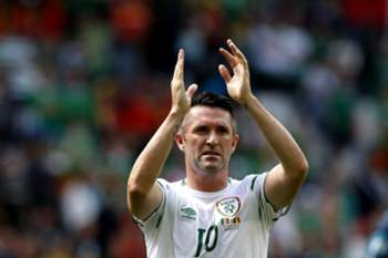 epa05375138 Robbie Keane of Ireland reacts after the UEFA EURO 2016 group E preliminary round match between Belgium and Ireland at Stade de Bordeaux in Bordeaux, France, 18 June 2016. (RESTRICTIONS APPLY: For editorial news reporting purposes only. Not used for commercial or marketing purposes without prior written approval of UEFA. Images must appear as still images and must not emulate match action video footage. Photographs published in online publications (whether via the Internet or otherwise) shall have an interval of at least 20 seconds between the posting.) EPA/RUNGROJ YONGRIT EDITORIAL USE ONLY