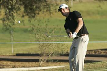 Portuguese golfer Ricardo Melo Gouveia watches his shot on the third day of the Portugal Masters 2012 golf tournament at Oceanic Golf Course in Vilamoura, southern Portugal, 13 October 2012.