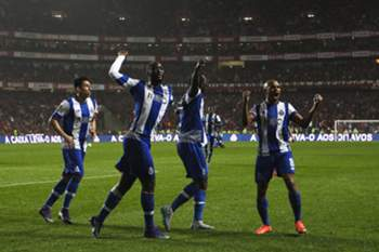 FC Porto`s (L-R) Herrera, Danilo, Aboubakar and Brahimi celebrate the scoring of a goal against Benfica during their Portuguese First League soccer match at Luz Stadium, in Lisbon, Portugal, 12th February 2016. MARIO CRUZ/LUSA
