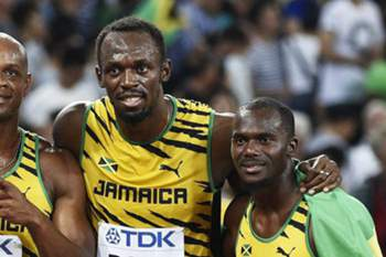 epa04903912 Jamaica's Nickel Ashmeade, Astafa Powell, Usain Bolt and Nesta Carter celebrate after winning gold in the 4x100m men relay during the Beijing 2015 IAAF World Championships at the National Stadium, also known as Bird's Nest, in Beijing, China, 29 August 2015. EPA/FRANCK ROBICHON