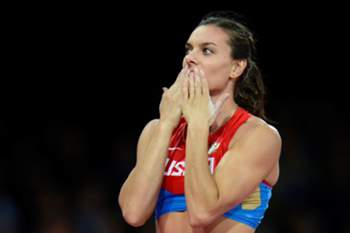 Russia's Yelena Isinbayeva reacts after succeeding in her attempt in the women's pole vault final at the athletics event of the London 2012 Olympic Games on August 6, 2012 in London. AFP PHOTO / ADRIAN DENNIS
