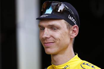 epa04839154 Etixx Quick Step team rider Tony Martin of Germany leaves the podium wearing the overall leader's yellow jersey following the 6th stage of the 102nd edition of the Tour de France 2015 cycling race over 191.5km between Abbeville and Le Havre, France, 09 July 2015. Martin was injured on his left arm after crashing in the final climb. EPA/KIM LUDBROOK