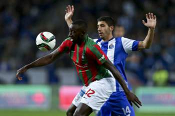 FC Porto's José Ángel (R) vies for the ball with Marítimo´s Moussa Marega during their Portuguese League Cup soccer match held at Dragao stadium in Porto, Portugal, 29 December 2015. ESTELA SILVA/LUSA
