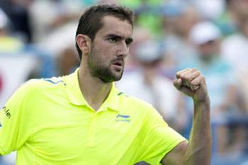 epa04877623 Marin Cilic of Croatia reacts after winning a point against Kei Nishikori of Japan during their semifinals match of the Citi Open tennis tournament, at Rock Creek Park Tennis Center in Washington, DC, USA, 08 August 2015. EPA/MICHAEL REYNOLDS