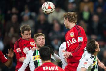 Leverkusen's Lars Bender (L) and Stefan Kiessling (2R) and Moenchengladbach's Christoph Kramer (2L) and Roel Brouwers vie for the ball during the German Bundesliga match between Bayer Leverkusen and Bor. Moenchengladbach at the Bay Arena in Leverkusen, Germany, 14 December 2014.