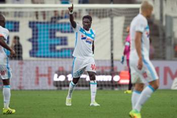 Olympique de Marseille's French forward Bafetimbi Gomis (C) gestures after scoring during the French Ligue 1 football match Olympique de Marseille versus Lorient on August 26, 2016 at the Velodrome stadium in Marseille, southern France.
