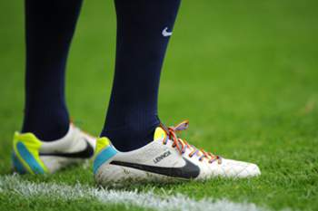 Everton's Dutch defender John Heitinga wears rainbow-coloured laces as part of a campaign against homophobia in football during the English Premier League football match between West Ham United and Everton at the Boleyn Ground, Upton Park, in east London on September 21, 2013. The English Premier League said on September 18 that it is happy for players to wear the rainbow-coloured laces against homophobia in football. Gay rights charity Stonewall is behind the initiative and has sent the striped laces to all 134 professional clubs in England and Scotland. AFP PHOTO / OLLY GREENWOOD RESTRICTED TO EDITORIAL USE. No use with unauthorized audio, video, data, fixture lists, club/league logos or ?live? services. Online in-match use limited to 45 images, no video emulation. No use in betting, games or single club/league/player publications.
