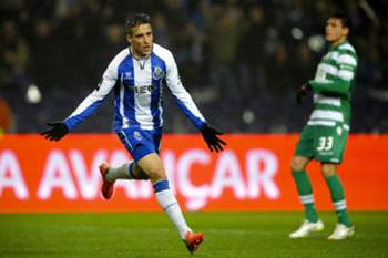 FC Porto's Spanish forward, Cristian Tello celebrates after scoring a goal against Sporting during their Portuguese First League soccer match held at Dragao stadium in Porto, Portugal, 1 March 2015.