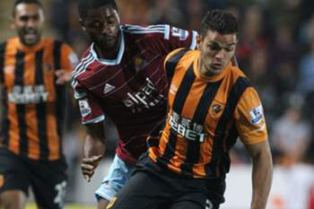 Hull City's French midfielder Hatem Ben Arfa (R) vies for the ball with West Ham United's Cameroonian midfielder Alex Song during the English Premier League football match between Hull City and West Ham United at the KC stadium in Kingston-upon-Hull, on September 15, 2014.