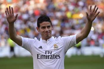 "Colombian striker formerly at AS Monaco James Rodriguez acknowledges the crowd during his presentation at the Santiago Bernabeu stadium following his signing with Spanish club Real Madrid in Madrid on July 22, 2014. Spanish media said Real paid about €80 million ($108m) for Rodriguez, making him one of the most expensive players ever. Neither club gave a figure, but Monaco said it was ""one of the biggest transfers in football history."" AFP PHOTO / PIERRE-PHILIPPE MARCOU"