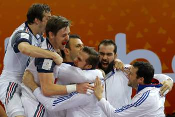 French players celebrate after winning the Qatar 2015 24th Men's Handball World Championship semi final match between Spain and France at the Lusail Multipurpose Hall outside Doha, Qatar, 30 January 2015. Qatar 2015 via