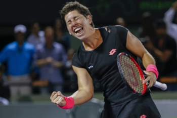 epaselect epa04688364 Carla Suarez Navarro of Spain celebrates after defeating Venus Williams of the United States during their quarter finals match at the Miami Open tennis tournament on Key Biscayne, Miami, Florida, USA, 31 March 2015. EPA/ERIK S. LESSER