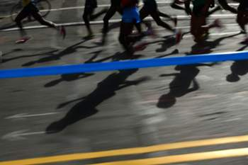 Men's professional runners take part in the New York City Marathon on November 3, 2013. AFP PHOTO/EMMANUEL DUNAND