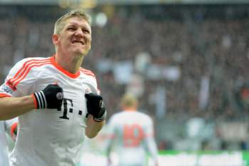 Bayern Munich's midfielder Bastian Schweinsteiger celebrates after his goal during the German first division Bundesliga football match between Eintracht Frankfurt and FC Bayern Muenchen in Frankfurt am Main, western Germany, on April 6, 2013. AFP PHOTO / CHRISTOF STACHE RESTRICTIONS / EMBARGO - DFL RULES TO LIMIT THE ONLINE USAGE DURING MATCH TIME TO 15 PICTURES PER MATCH. IMAGE SEQUENCES TO SIMULATE VIDEO IS NOT ALLOWED AT ANY TIME. FOR FURTHER QUERIES PLEASE CONTACT THE DFL DIRECTLY AT + 49 69 650050