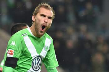 Bas Dost of VfL Wolfsburg celebrates scoring the opening goal during the German Bundesliga match VfL Wolfsburg vs FC Bayern Munich in Wolfsburg, Germany, 30 January 2015. (ATTENTION: Due to the accreditation guidelines, the DFL only permits the publication and utilisation of up to 15 pictures per match on the internet and in online media during the match.)