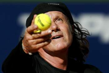Legendary Argentinean tennis player Guillermo Vilas plays against his opponent Swedish Bjorn Borg, during an exhibition game at the 'Tenis de Ases' eventat the Stadium Parque Roca in Buenos Aires, Argentina, 14 March 2008. Swedish Mats Wilander and Australian Pat Cash also participated in the event.
