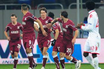 Ciprian Deac (3rd L) celebrates with his teammates after scoring his team's first goal from penalty during the UEFA Europa League, Group C, football match between Rapic Bucarest and Hapoel Tel-Aviv in Bucharest November 30, 2011.