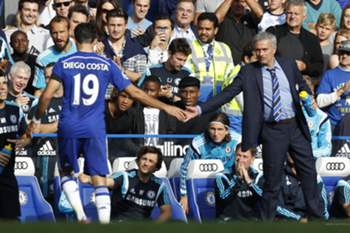 "Chelsea's Brazilian-born Spanish striker Diego Costa (L) gestures to Chelsea's Portuguese manager Jose Mourinho after being substituted during the English Premier League football match between Chelsea and Swansea City at Stamford Bridge in London on September 13, 2014. Chelsea won 4-1. AFP PHOTO/IAN KINGTON - RESTRICTED TO EDITORIAL USE. No use with unauthorized audio, video, data, fixture lists, club/league logos or ""live"" services. Online in-match use limited to 45 images, no video emulation. No use in betting, games or single club/league/player publications."