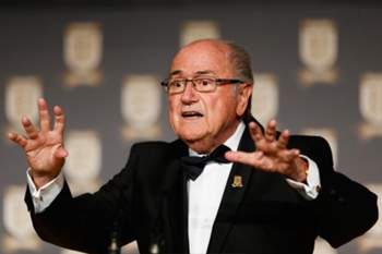 """FIFA President Sepp Blatter talks on stage at The Football Association's 150th Anniversary Gala Dinner at the Grand Connaught Rooms in central London on October 26, 2013. The event marks the day when a group of men on October 26, 1863 representing a dozen London and suburban clubs met at the Freemason's Tavern in London, to draw up the rules of a sport that went on to become the most popular in the world. RESTRICTED TO EDITORIAL USE - MANDATORY CREDIT """" AFP PHOTO / FA / TOM SHAW """" - NO MARKETING NO ADVERTISING CAMPAIGNS - DISTRIBUTED AS A SERVICE TO CLIENTS"""