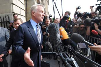 """Head of the International Motoring Federation (FIA) Max Mosley (C) answers journalists' questions as he leaves the FIA headquarters in Paris on September 21, 2009, after a hearing at the World Motor Sports Council as part of the """"crashgate"""" affair.The Renault Formula One team were handed a two year suspended ban by the International Automobile Federation (FIA) for ordering Nelson Piquet junior to crash in the 2008 Singapore Grand Prix. Renault were in the dock for conspiring with Piquet junior to cause a deliberate crash to help the Brazilian's teammate, Fernando Alonso, win the race. AFP PHOTO BORIS HORVAT"""