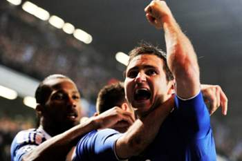 Chelsea's English midfielder Frank Lampard (R) celebrates English defender John Terry scoring the second goal during their UEFA Champions League round of 16 second leg football match against Napoli at Stamford Bridge, London, on March 14, 2012. AFP PHOTO/GLYN KIRK
