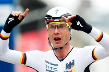 Tony Martin of Germany reacts as he crosses the finish line to win the Men's Elite time trial at the UCI Road Cycling World Championships on September 21, 2011 in Copenhagen. The UCI Cycling Road World Championships are held from September 19 until September 25. AFP PHOTO/JONATHAN NACKSTRAND