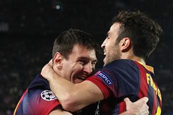 Fabregas e Messi nos tempos do Barcelona.