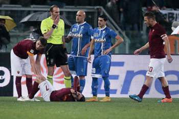 Roma's Juan Manuel Iturbe (botttom) lies injured on the pitch during the Italian Serie A soccer match AS Roma vs Empoli FC at Olimpico stadium in Rome, Italy, 31 January 2015.