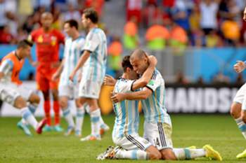 epaselect epa04301228 Martin Demichelis (C-L) and Javier Mascherano (C-R) of Argentina celebrate after winning the FIFA World Cup 2014 quarter final match between Argentina and Belgium at the Estadio Nacional in Brasilia, Brazil, 05 July 2014. (RESTRICTIONS APPLY: Editorial Use Only, not used in association with any commercial entity - Images must not be used in any form of alert service or push service of any kind including via mobile alert services, downloads to mobile devices or MMS messaging - Images must appear as still images and must not emulate match action video footage - No alteration is made to, and no text or image is superimposed over, any published image which: (a) intentionally obscures or removes a sponsor identification image; or (b) adds or overlays the commercial identification of any third party which is not officially associated with the FIFA World Cup) EPA/PETER POWELL EDITORIAL USE ONLY
