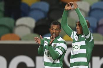 Sporting`s Joao Mario (R) celebrates with teammate Nani after scoring against Rio Ave during their Portuguese First League soccer match, held at Jose Alvalade Stadium, in Lisbon, Portugal, 18 January 2015. TIAGO PETINGA/LUSA