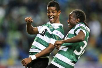 Sporting´s players Heldon (L) and Carlos Mané (R) celebrates after scoring the 1 -0 lead during the Portuguese First League soccer match between Sporting´s and Olhanense at Alvalade Stadium in Lisbon, Portugal, 15 February 2014. EPA/MIGUEL A. LOPES