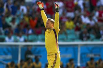epa04261527 Germany's goalkeeper Manuel Neuer celebrates during the FIFA World Cup 2014 group G preliminary round match between Germany and Portugal at the Arena Fonte Nova in Salvador, Brazil, 16 June 2014. (RESTRICTIONS APPLY: Editorial Use Only, not used in association with any commercial entity - Images must not be used in any form of alert service or push service of any kind including via mobile alert services, downloads to mobile devices or MMS messaging - Images must appear as still images and must not emulate match action video footage - No alteration is made to, and no text or image is superimposed over, any published image which: (a) intentionally obscures or removes a sponsor identification image; or (b) adds or overlays the commercial identification of any third party which is not officially associated with the FIFA World Cup) EPA/JOSE SENA GOULAO EDITORIAL USE ONLY