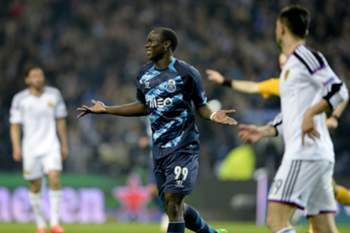 FC Porto's Cameroon forward, Vincent Aboubakar, celebrates after scoring against FC Basel during their UEFA Champions League soccer match Group H round of sixteen, second leg, held at Dragao stadium in Porto, Portugal, 10 March 2015. FERNANDO VELUDO / LUSA
