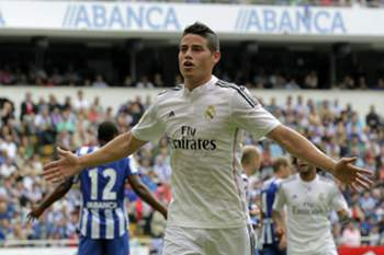 epa04409137 Real Madrid's Colombian midfielder James Rodriguez celebrates after scoring against Deportivo Coruna during the Spanish Liga Primera Division soccer match played at Riazor stadium, in La Coruna, northwestern Spain, 20 September 2014. EPA/LAVANDEIRA JR.