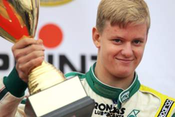 Mick Schumacher (2nd place) of Germany, named as Mick Junior, of KSM Racing Team, poses with his cup during the DJKM award ceremony at the German Karting Championship in Genk, Belgium, 05 October 2014.