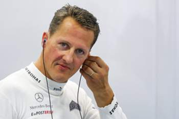epa04260522 (FILE) A file picture dated 21 September 2012 shows German Formula One driver Michael Schumacher adjusting his earpiece before the first practice session at the Marina Bay Street Circuit in Singapore. Formula 1 racer Michael Schumacher is no longer in a coma, it was reported 16 June 2014 by his manager Sabine Kehm, six and a half months after he suffered a serious skiing injury. Reports also state he has left the Grenoble hospital he was staying in. EPA/DIEGO AZUBEL *** Local Caption *** 50529693